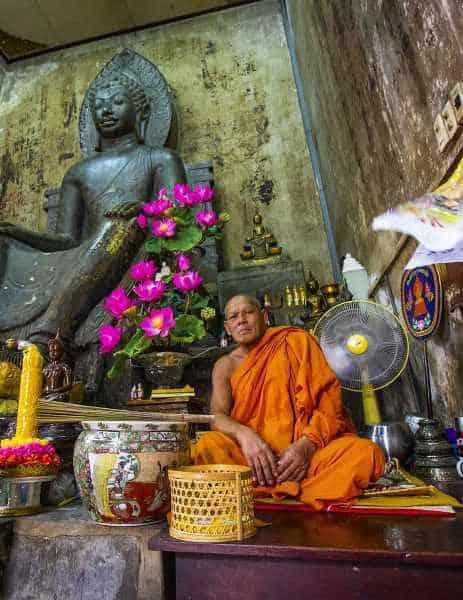 Ayutthaya Buddhist monk sitting inside temple